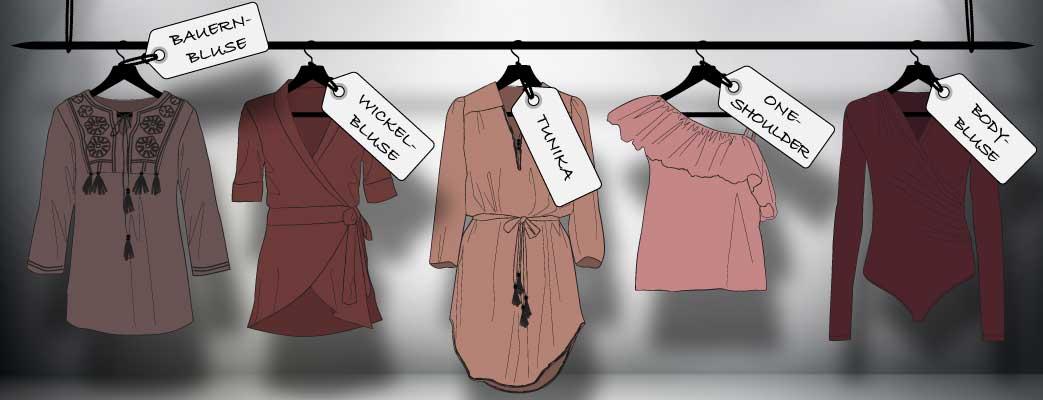 Forskellige bluser i udstillingsvindue